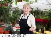 Купить «Portrait of female gardener who is working together», фото № 30653274, снято 23 февраля 2018 г. (c) Яков Филимонов / Фотобанк Лори