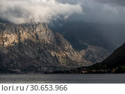 Купить «Sunlight falling on mountain, Bay of Kotor, Montenegro», фото № 30653966, снято 9 сентября 2017 г. (c) Ingram Publishing / Фотобанк Лори