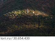 Купить «Sunlight falling on church building surrounded by trees, Montenegro», фото № 30654430, снято 9 сентября 2017 г. (c) Ingram Publishing / Фотобанк Лори
