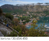 Купить «Aerial view of coastal town seen from the way to Kotor Fortress, Kotor, Bay of Kotor, Montenegro», фото № 30654450, снято 20 сентября 2019 г. (c) Ingram Publishing / Фотобанк Лори