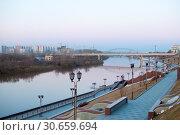 Купить «Tyumen, Russia, on April 19, 2019: The embankment in Tyumen in the evening», фото № 30659694, снято 19 апреля 2019 г. (c) Землянникова Вероника / Фотобанк Лори