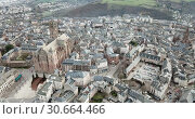 Купить «Aerial view of French city of Rodez with tower of Cathedral and spire of church of Saint Amans in autumn day», видеоролик № 30664466, снято 4 января 2019 г. (c) Яков Филимонов / Фотобанк Лори