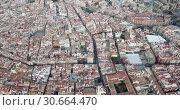 Купить «Panoramic aerial perspective of Reus cityscape, Tarragona, Catalonia», видеоролик № 30664470, снято 17 января 2019 г. (c) Яков Филимонов / Фотобанк Лори