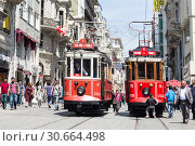 Vintage tram on the Taksim Street in Istanbul, Turkey. Nostalgic tram of Istanbul is the heritage tramway system. It was re-established in 1990. (2015 год). Редакционное фото, фотограф Наталья Волкова / Фотобанк Лори