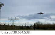 Купить «Passenger plane landing in airport on time», видеоролик № 30664538, снято 26 февраля 2019 г. (c) Яков Филимонов / Фотобанк Лори
