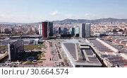 Купить «Panoramic aerial view of business district of Gran Via and Placa d Europa with modern skyscrapers», видеоролик № 30664574, снято 19 марта 2019 г. (c) Яков Филимонов / Фотобанк Лори