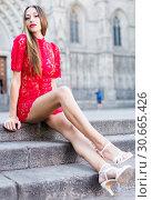 Купить «portrait of young adult girl in evening apparel sitting in european town», фото № 30665426, снято 24 июня 2017 г. (c) Яков Филимонов / Фотобанк Лори