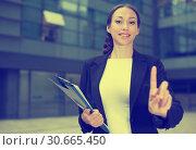 Купить «Female office manager is asking companion to wait», фото № 30665450, снято 26 июня 2017 г. (c) Яков Филимонов / Фотобанк Лори