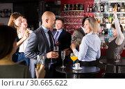 Jolly man and woman on corporate party. Стоковое фото, фотограф Яков Филимонов / Фотобанк Лори