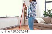 Купить «woman with sweeping broom brush cleaning floor», видеоролик № 30667574, снято 15 апреля 2019 г. (c) Syda Productions / Фотобанк Лори