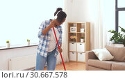 Купить «woman with sweeping broom brush cleaning floor», видеоролик № 30667578, снято 15 апреля 2019 г. (c) Syda Productions / Фотобанк Лори
