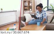Купить «woman with tablet pc resting after home cleaning», видеоролик № 30667674, снято 15 апреля 2019 г. (c) Syda Productions / Фотобанк Лори