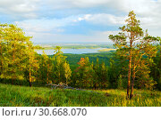 Купить «Forest landscape with mixed forest trees on the mountain slopes and lake under soft sunset light», фото № 30668070, снято 23 августа 2013 г. (c) Зезелина Марина / Фотобанк Лори