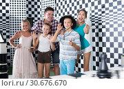 Купить «Young family is satisfied of visit», фото № 30676670, снято 3 августа 2017 г. (c) Яков Филимонов / Фотобанк Лори