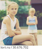 Купить «Two quarreled little girls», фото № 30676702, снято 20 июля 2017 г. (c) Яков Филимонов / Фотобанк Лори