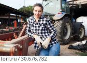 Купить «Woman near agricultural machinery», фото № 30676782, снято 8 августа 2018 г. (c) Яков Филимонов / Фотобанк Лори