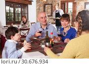 Купить «Happy family having dinner», фото № 30676934, снято 12 декабря 2018 г. (c) Яков Филимонов / Фотобанк Лори