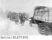 Купить «BELGIUM Sourbrodt -- 19 Jan 1945 -- Snow and ice make the going tough for US 1st Army vehicles on a road in Belgium. The snowstorm was responsible for...», фото № 30677810, снято 23 мая 2012 г. (c) age Fotostock / Фотобанк Лори