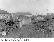Купить «BELGIUM Vielsalm -- 23 Dec 1944 -- A US Army 7th Armored Division antitank gun covers the approach on a road to a railway crossing near Vielsalm, Belgium...», фото № 30677826, снято 23 мая 2012 г. (c) age Fotostock / Фотобанк Лори
