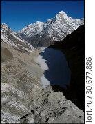 Купить «NEPAL Trakarding Glacier -- 16 Apr 2005 -- Aerial view of Tsho Rolpa - a glacial lake at the foot of the Trakarding Glacier, which is remarkable as it...», фото № 30677886, снято 23 мая 2019 г. (c) age Fotostock / Фотобанк Лори