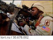 Купить «IRAQ Kirkuk -- 31 Dec 2003 -- US Army paratrooper aims a M-60 machine gun at a nearby building during an engagement with Iraqi insurgents after shooting...», фото № 30678002, снято 26 мая 2019 г. (c) age Fotostock / Фотобанк Лори