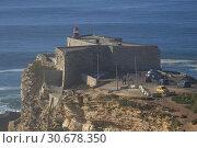 Купить «PORTUGAL Nazare -- 04 Jan 2015 -- Since professional surfers began breaking records in 2011, the Farol da Nazare (Nazare lighthouse) situated on the Forte...», фото № 30678350, снято 10 января 2015 г. (c) age Fotostock / Фотобанк Лори