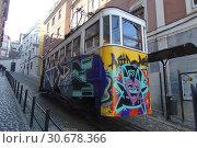 Купить «PORTUGAL Lisbon -- 08 Dec 2014 -- Grafitti on the La Gloria elevador tram in Baixa Lisbon Portugal -- Picture by Jonathan Mitchell/Atlas Photo Archive.», фото № 30678366, снято 21 декабря 2014 г. (c) age Fotostock / Фотобанк Лори