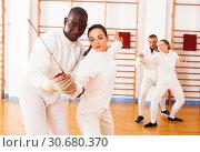 Купить «fencer practicing movements with african american trainer», фото № 30680370, снято 11 июля 2018 г. (c) Яков Филимонов / Фотобанк Лори