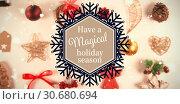 "Composite image of snowflake ""have a magical holiday season"" Стоковое фото, агентство Wavebreak Media / Фотобанк Лори"