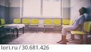 Купить «Patient sitting in a waiting room», фото № 30681426, снято 6 апреля 2020 г. (c) Wavebreak Media / Фотобанк Лори