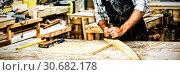 Купить «Carpenter working on his craft», фото № 30682178, снято 23 октября 2019 г. (c) Wavebreak Media / Фотобанк Лори