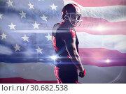 Купить «Composite image of american football player standing in helmet», фото № 30682538, снято 19 июня 2019 г. (c) Wavebreak Media / Фотобанк Лори