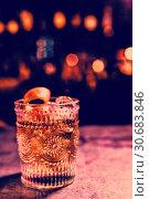 Купить «Orange cocktail in glass at counter in bar», фото № 30683846, снято 19 июня 2019 г. (c) Wavebreak Media / Фотобанк Лори