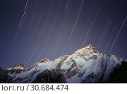 Купить «File image dated Dec 2005 of the summit of Mount Everest (just visible centre peak) in Nepal with a time exposure. The 29th May is the anniversary of the...», фото № 30684474, снято 24 сентября 2007 г. (c) age Fotostock / Фотобанк Лори