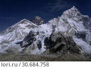 Купить «The world's tallest mountain Mount Everest (centre left) and Mount Nuptse (right) from Pumo Ri Base Camp in the Khumbu Himalaya of Nepal.», фото № 30684758, снято 30 декабря 2005 г. (c) age Fotostock / Фотобанк Лори