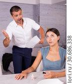 Купить «Husband scolding wife painting nails», фото № 30686338, снято 17 июля 2018 г. (c) Яков Филимонов / Фотобанк Лори