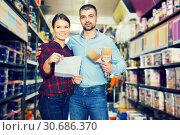 Купить «Couple with shop list in store», фото № 30686370, снято 16 февраля 2018 г. (c) Яков Филимонов / Фотобанк Лори