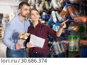 Купить «Two glad designer holding brushes in the store», фото № 30686374, снято 16 февраля 2018 г. (c) Яков Филимонов / Фотобанк Лори
