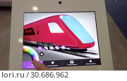 Купить «Exhibition visitor choosing the color of future trains on a tablet with a touch screen», видеоролик № 30686962, снято 16 апреля 2019 г. (c) Антон Гвоздиков / Фотобанк Лори