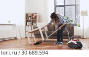 Купить «asian woman with vacuum cleaner at home», видеоролик № 30689594, снято 25 апреля 2019 г. (c) Syda Productions / Фотобанк Лори