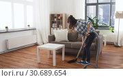 Купить «asian woman with vacuum cleaner at home», видеоролик № 30689654, снято 25 апреля 2019 г. (c) Syda Productions / Фотобанк Лори
