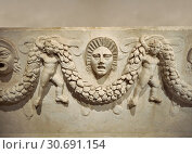 Close up picture of Roman relief sculpted Sarcophagus of Garlands, 2nd century AD, Perge. This type of sarcophagus is described as a â. œPamphylia Type... (2012 год). Редакционное фото, фотограф Funkystock / age Fotostock / Фотобанк Лори