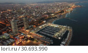 Купить «View from drones of coast in Barcelona and center with building», видеоролик № 30693990, снято 25 декабря 2018 г. (c) Яков Филимонов / Фотобанк Лори