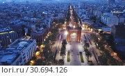 Купить «Aerial view of iconic landmark of Barcelona - Triumphal Arch (Arco de Triunfo) on central avenue at twilight, Spain», видеоролик № 30694126, снято 25 апреля 2019 г. (c) Яков Филимонов / Фотобанк Лори