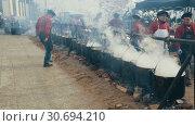 Купить «FEBRUARY 13, 2018: Feast of escudella soup, oldest of city holidays of Castelltercol», видеоролик № 30694210, снято 13 февраля 2018 г. (c) Яков Филимонов / Фотобанк Лори