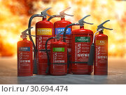 Fire extinguishers on a fire background. Various types and different sizes of extinguishers. 3d illustration. Стоковое фото, фотограф Maksym Yemelyanov / Фотобанк Лори