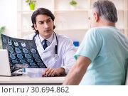Купить «Old man visiting young male doctor», фото № 30694862, снято 9 января 2019 г. (c) Elnur / Фотобанк Лори