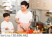 Купить «Happy mother and son cooking», фото № 30696442, снято 28 марта 2019 г. (c) Яков Филимонов / Фотобанк Лори