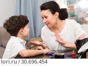 Купить «Happy woman chatting with son», фото № 30696454, снято 28 марта 2019 г. (c) Яков Филимонов / Фотобанк Лори