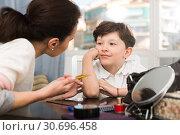 Купить «Dreamy boy listening to mother», фото № 30696458, снято 28 марта 2019 г. (c) Яков Филимонов / Фотобанк Лори